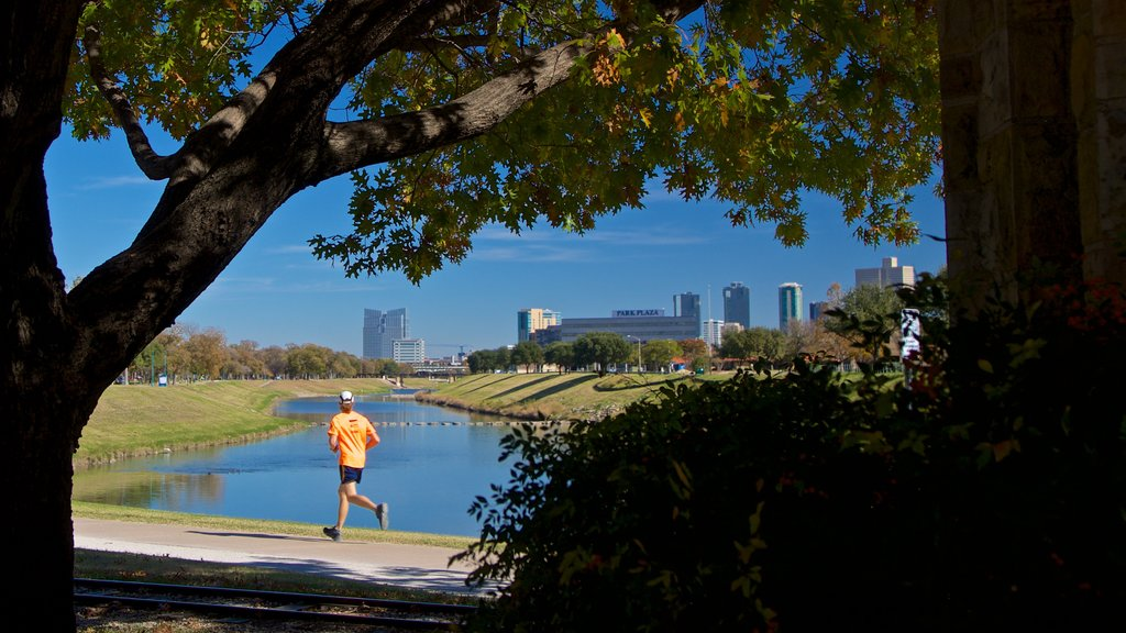 Trinity Park featuring hiking or walking and a river or creek as well as an individual male