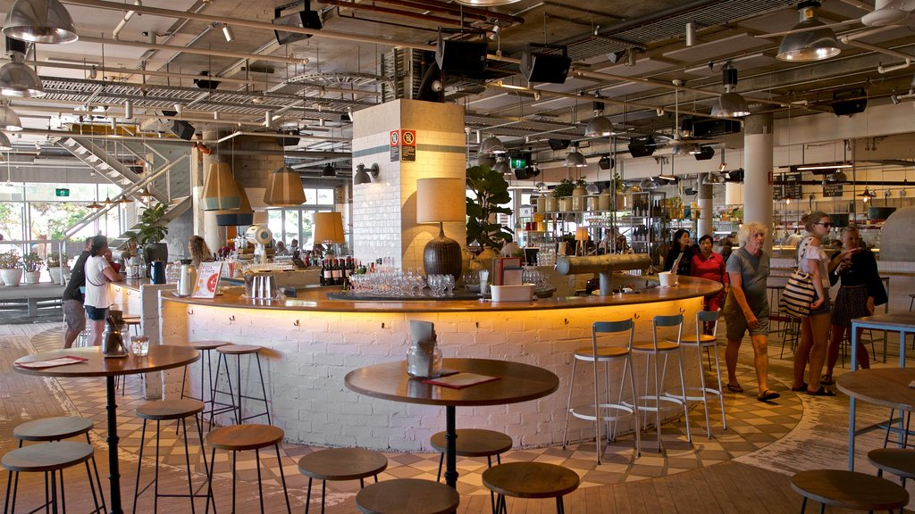 Sydney featuring interior views and a bar as well as a small group of people