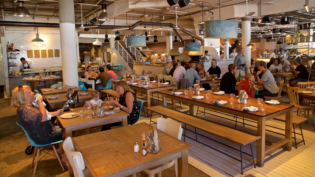 Sydney featuring dining out and interior views as well as a small group of people