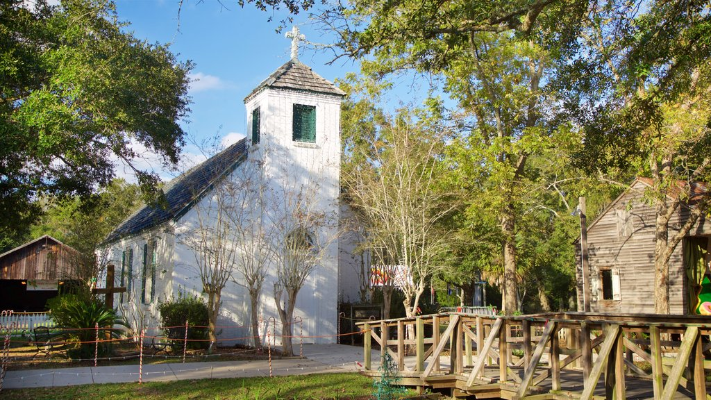 Acadian Village which includes a church or cathedral