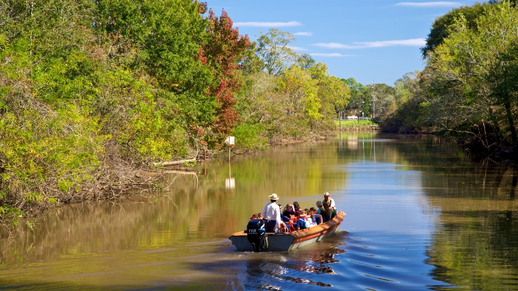 Vermilionville featuring a river or creek and boating as well as a small group of people