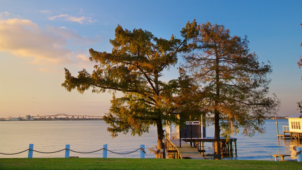Lake Charles which includes a sunset and a lake or waterhole