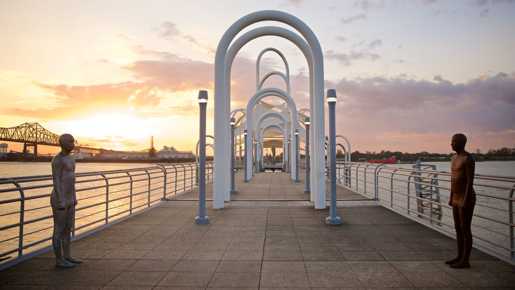 Baton Rouge showing a statue or sculpture, outdoor art and a sunset