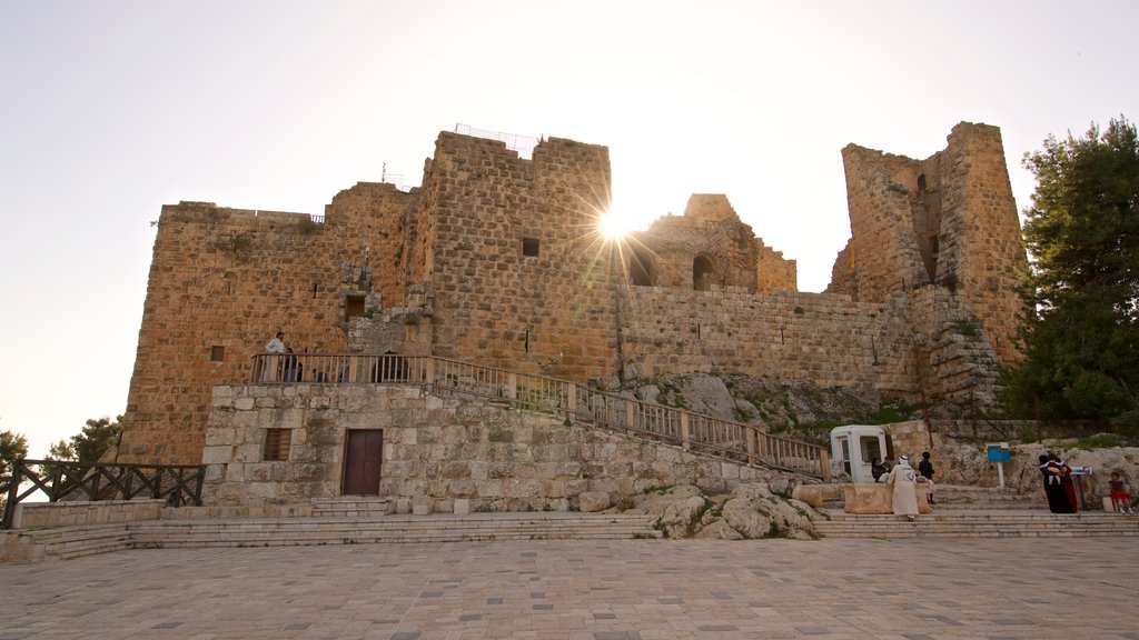 Ajloun Castle showing heritage architecture and a sunset