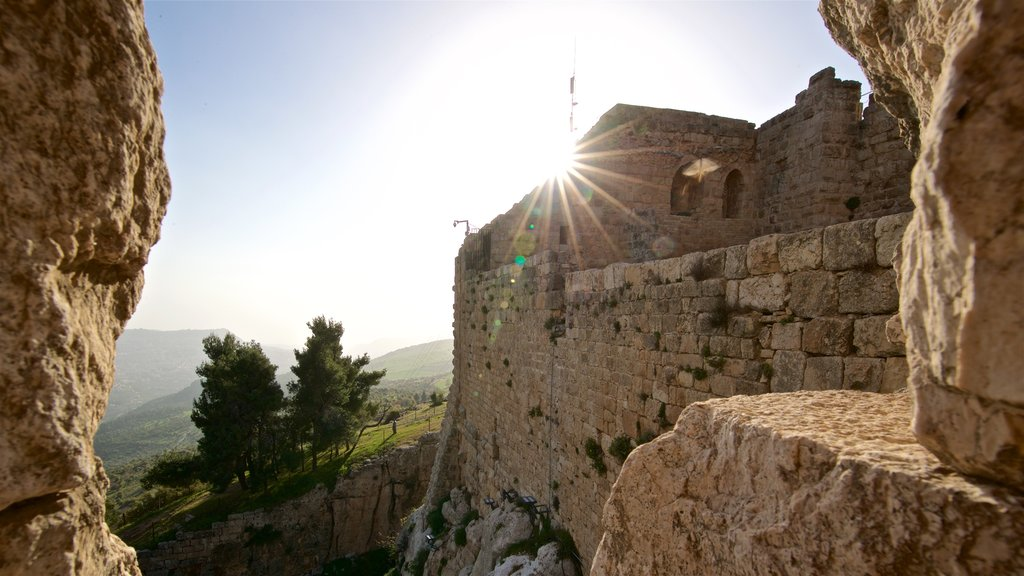 Ajloun Castle showing heritage elements and a sunset