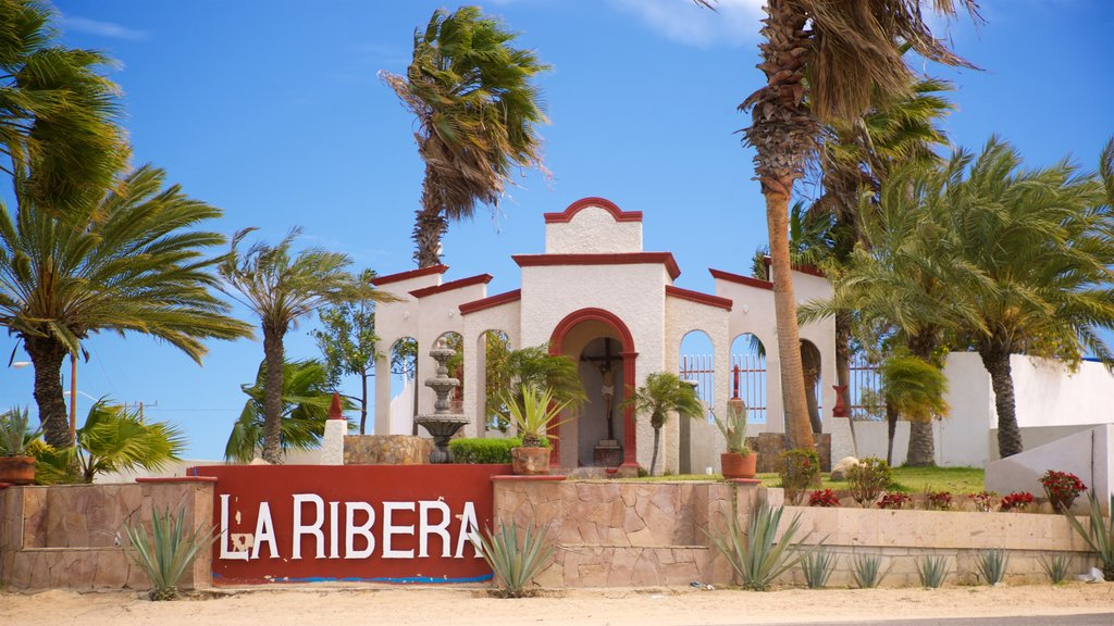La Ribera featuring a church or cathedral and signage