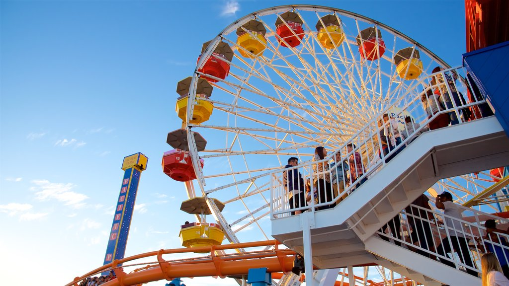 Santa Monica Pier which includes rides as well as a small group of people