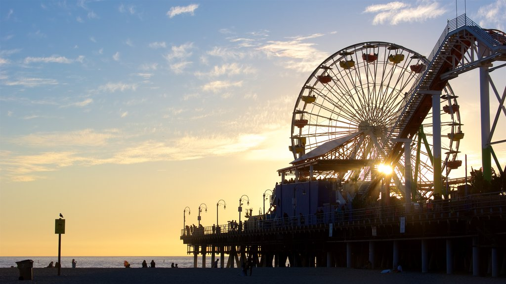 Santa Monica Pier featuring general coastal views, a sunset and rides