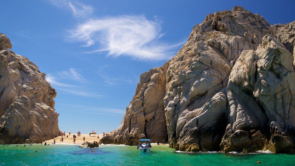 Playa del Amor featuring rocky coastline and general coastal views