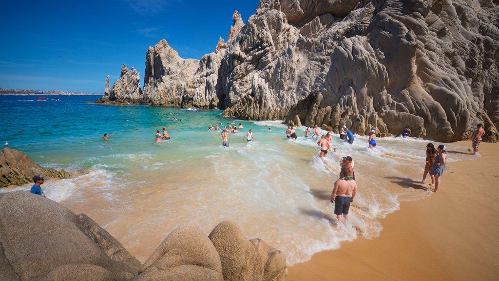 Playa del Amor que incluye vistas generales de la costa, costa escarpada y natación
