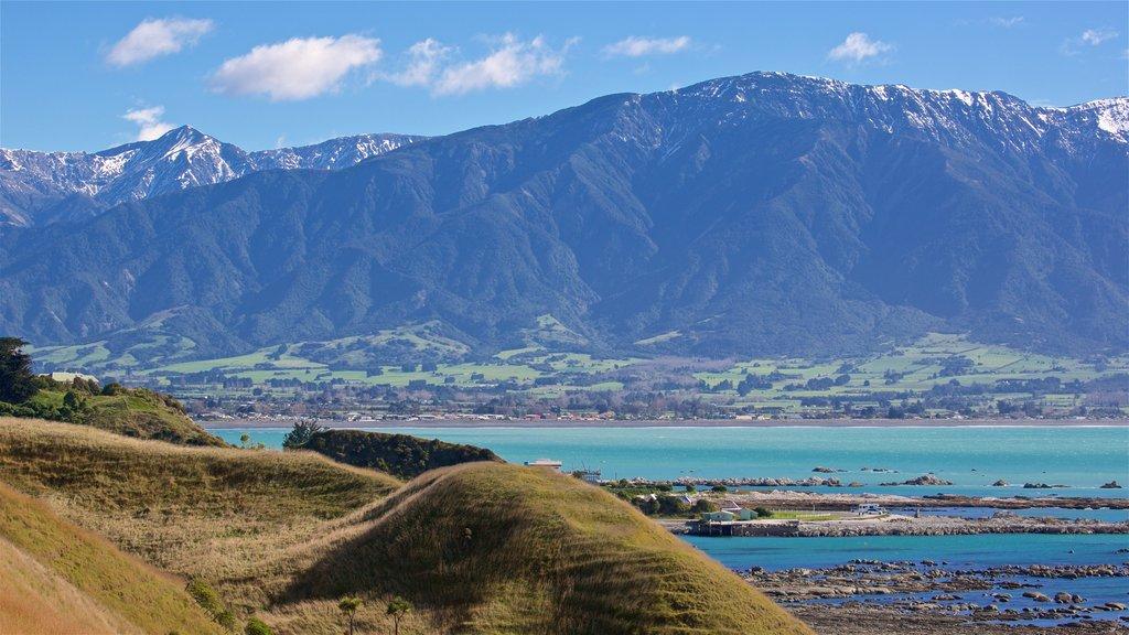 Peninsula Walkway ofreciendo escenas tranquilas, montañas y vistas de paisajes