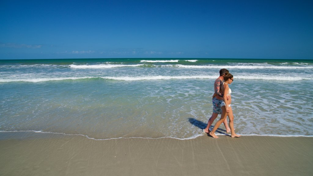 Cocoa Beach featuring general coastal views and a sandy beach as well as a couple