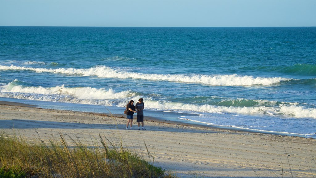Melbourne Beach which includes a beach and general coastal views as well as a couple