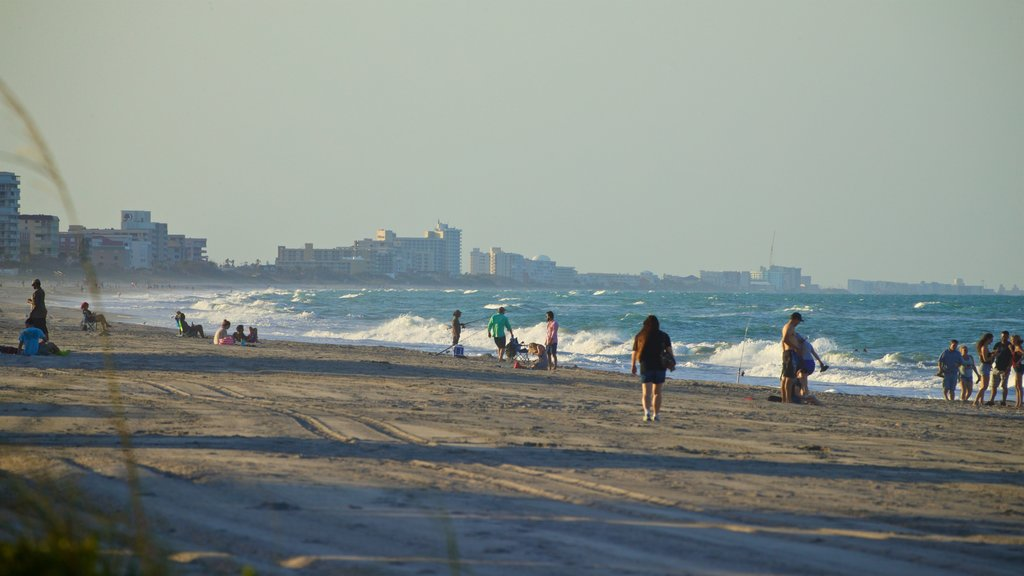 Melbourne Beach which includes a beach and general coastal views as well as a small group of people