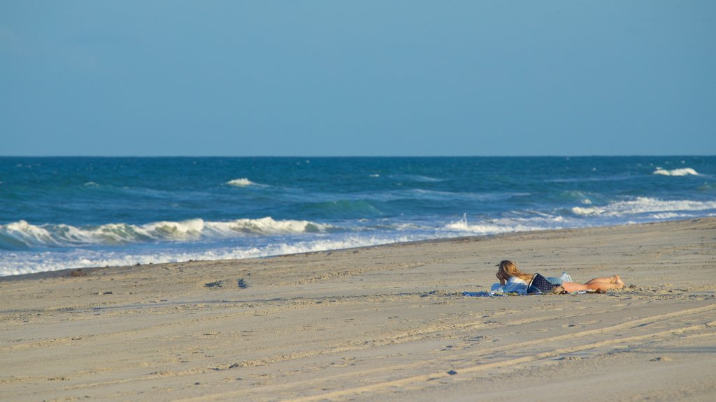 Melbourne Beach showing a sandy beach and general coastal views as well as a couple