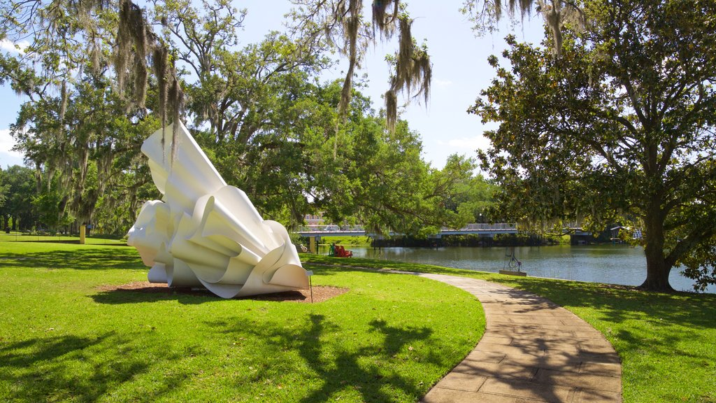 Mennello Museum of American Art featuring outdoor art, a lake or waterhole and a park