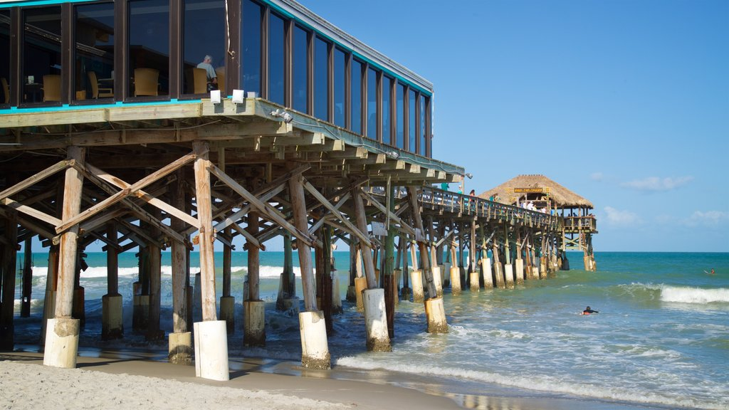 Cocoa Beach Pier which includes a sandy beach and general coastal views