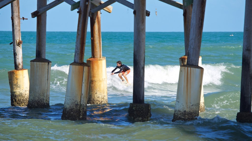 Cocoa Beach Pier featuring general coastal views, surfing and waves