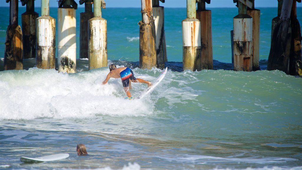 Cocoa Beach Pier which includes general coastal views, waves and surfing