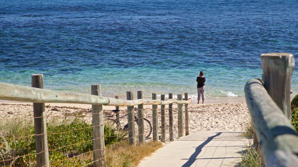 Trigg Beach which includes a beach and general coastal views as well as an individual male