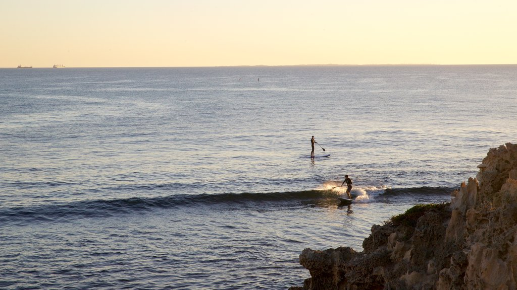 Cottesloe Beach which includes surf, general coastal views and surfing