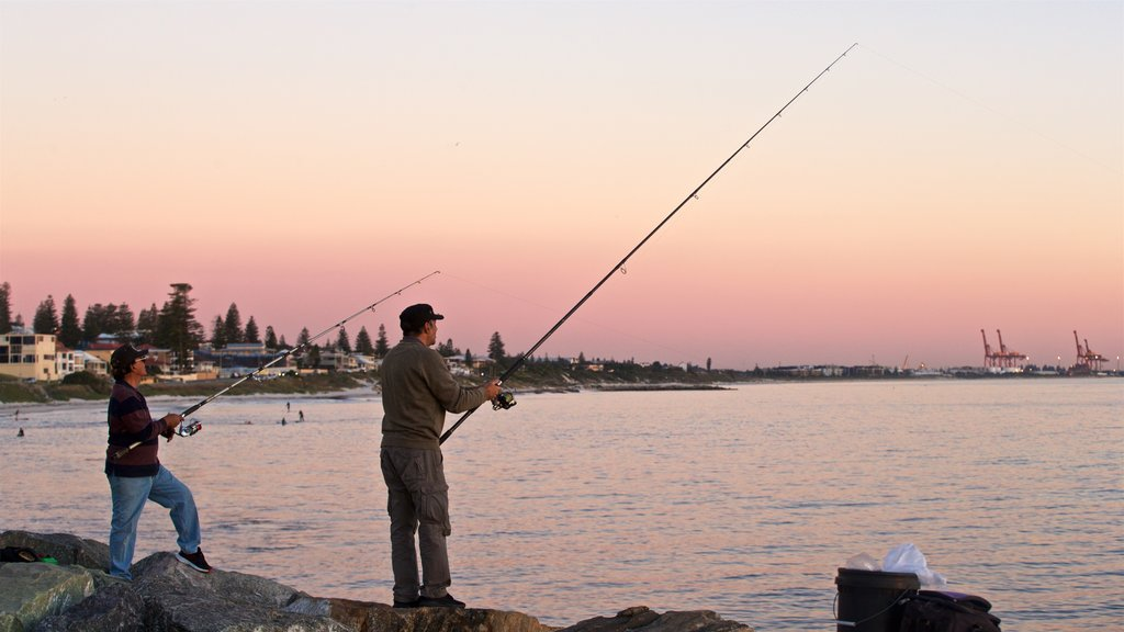Cottesloe Beach featuring a sunset, general coastal views and fishing