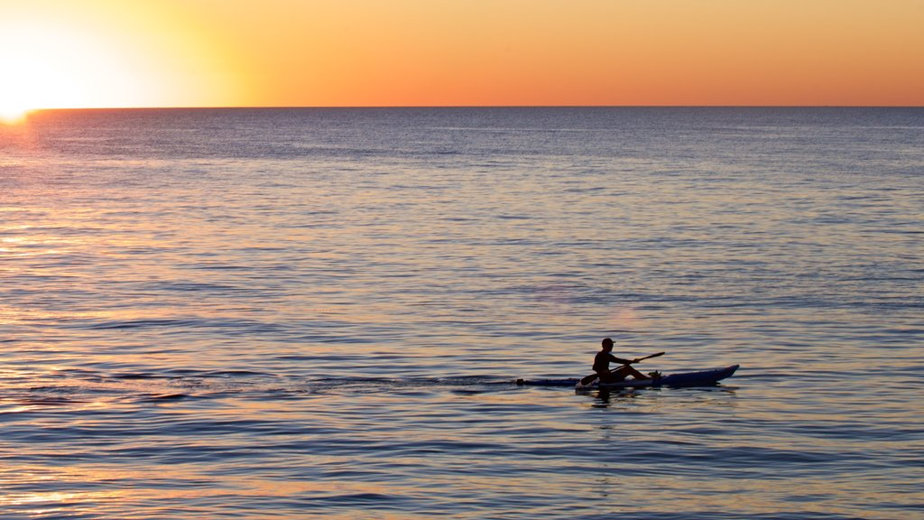 Cottesloe Beach which includes a sunset, general coastal views and kayaking or canoeing