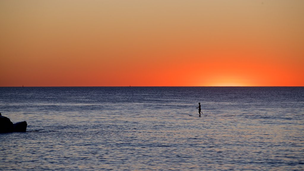 Cottesloe Beach featuring general coastal views, a sunset and kayaking or canoeing