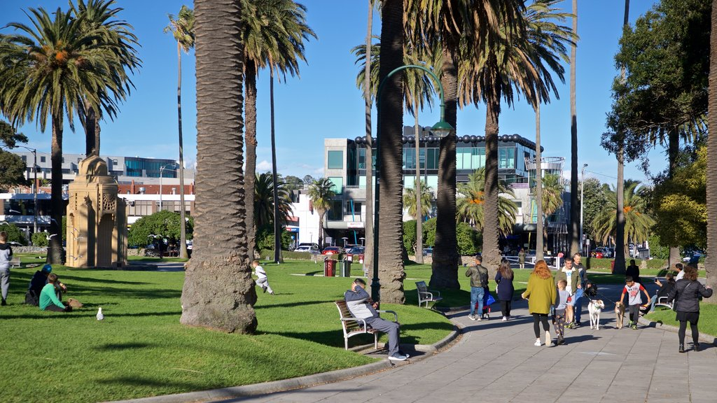 St Kilda which includes a park as well as a small group of people