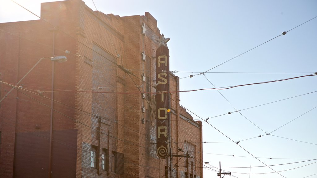 Astor Theatre which includes signage and a sunset