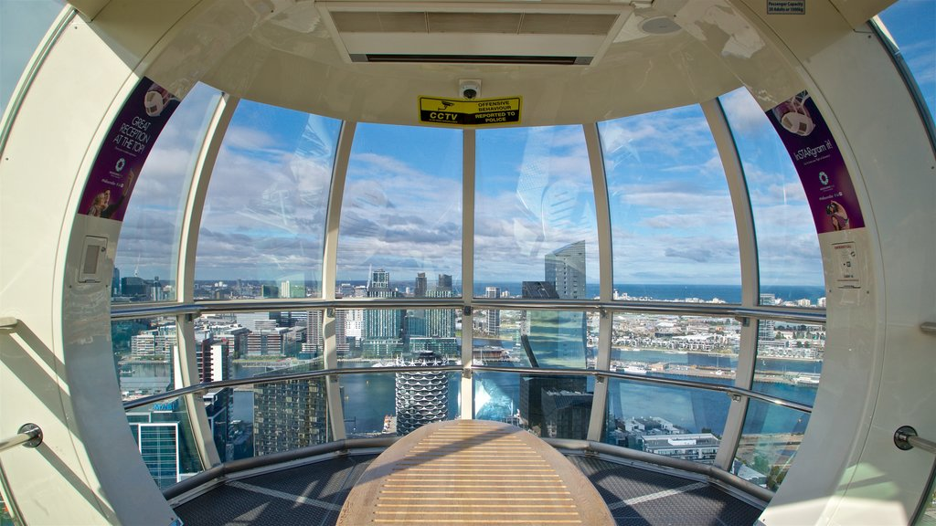 Melbourne Star Observation Wheel which includes views, a city and interior views