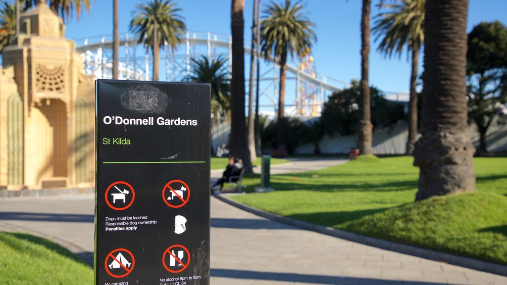 St Kilda showing signage and a garden