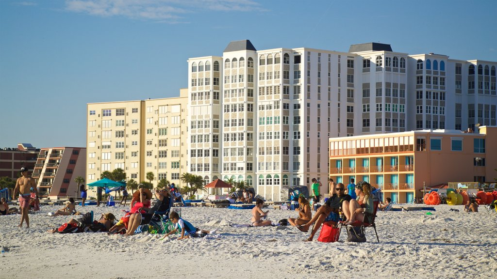 St. Pete Beach featuring a beach and a coastal town as well as a small group of people