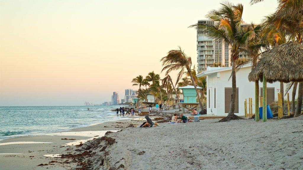 Dania Beach showing a beach, general coastal views and a sunset