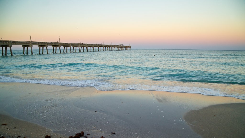 Dania Beach showing a sandy beach, general coastal views and a sunset
