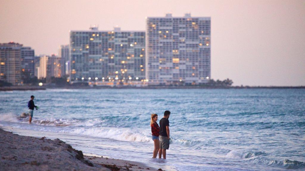 Dania Beach featuring a sunset, general coastal views and a beach