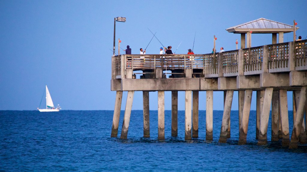 Dania Beach featuring fishing and general coastal views as well as a small group of people