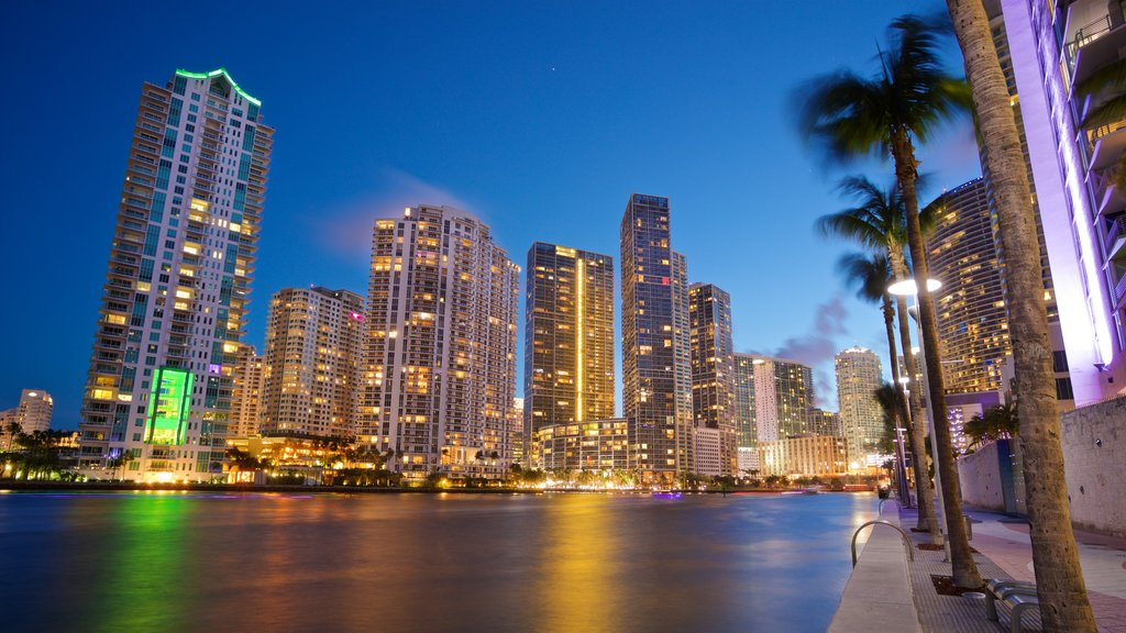 Downtown Miami showing a river or creek, night scenes and a city