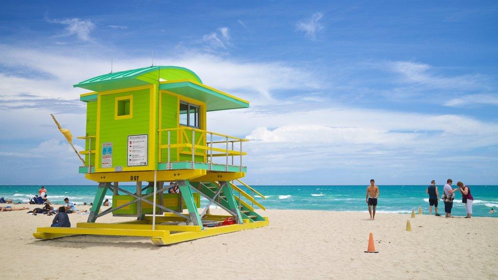 Lummus Park Beach which includes a sandy beach and general coastal views as well as an individual male