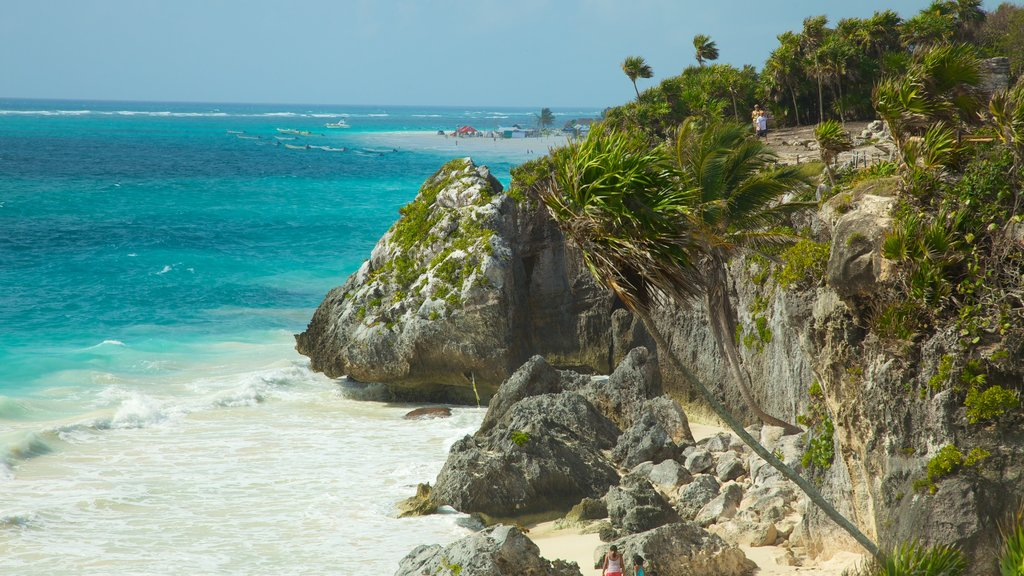 Tulum Mayan Ruins which includes rocky coastline, landscape views and tropical scenes