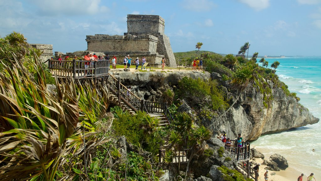 Tulum Mayan Ruins which includes rugged coastline, general coastal views and building ruins