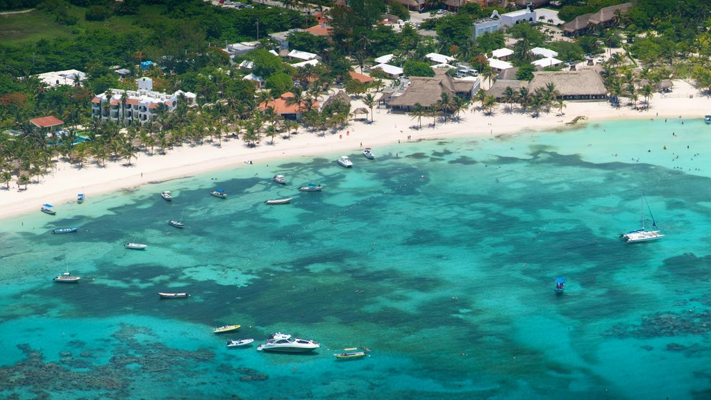 Riviera Maya which includes boating, a sandy beach and tropical scenes