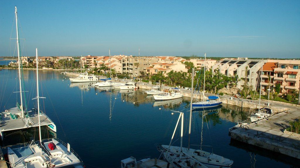 Riviera Maya which includes a coastal town, a bay or harbor and a marina