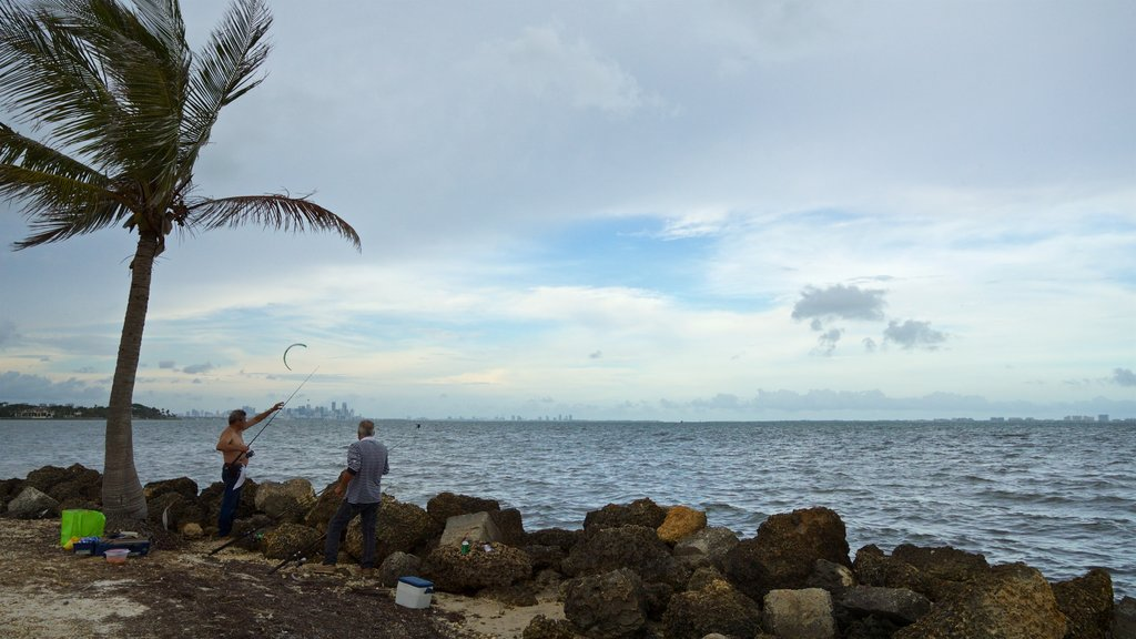 Miami featuring fishing and general coastal views as well as a small group of people