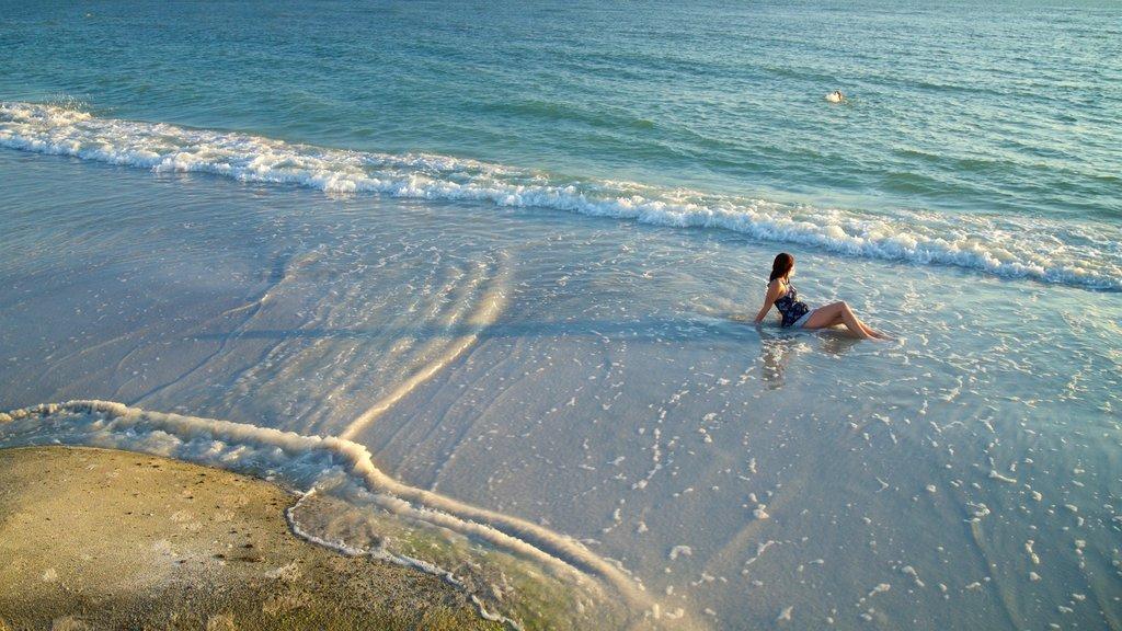Upham Beach which includes a sandy beach and general coastal views as well as an individual femail