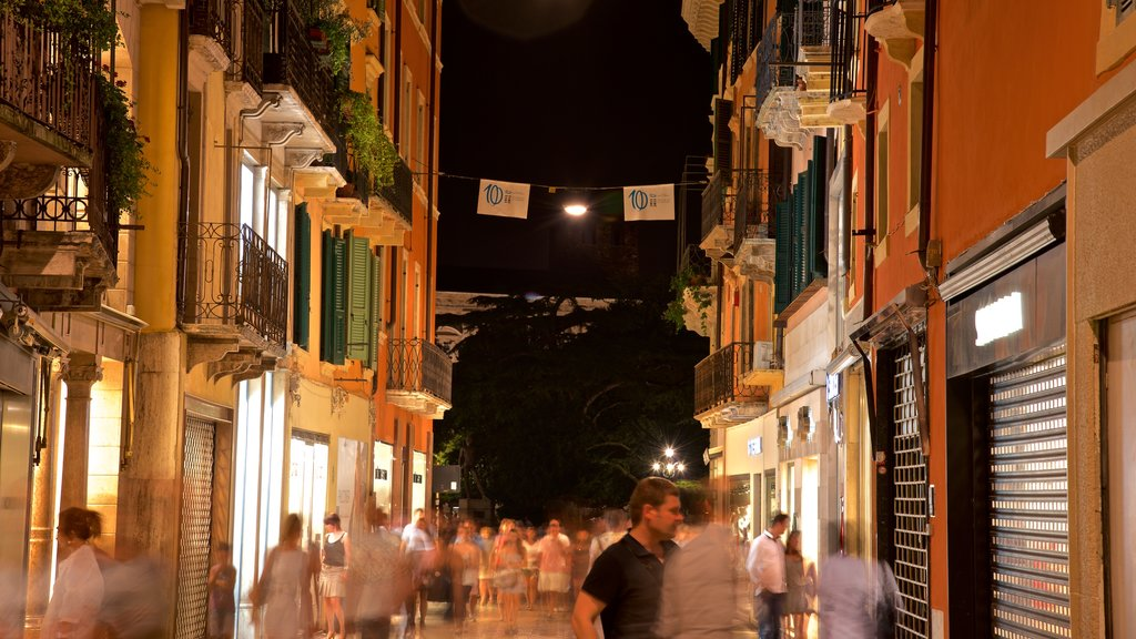 Verona featuring street scenes and night scenes as well as a small group of people