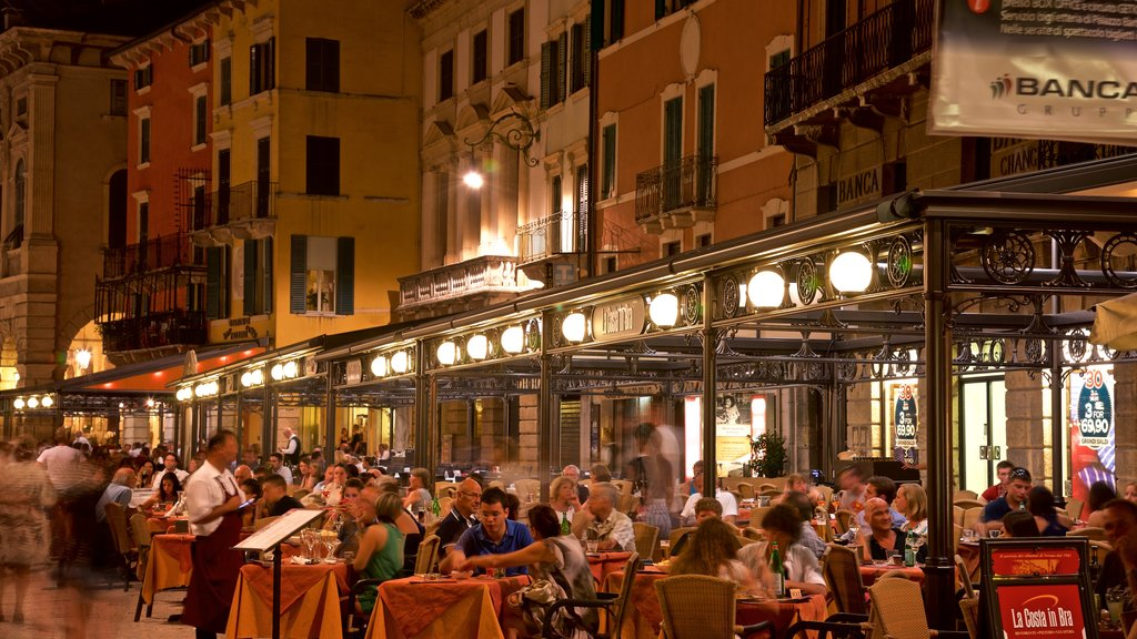 Verona showing dining out, outdoor eating and night scenes