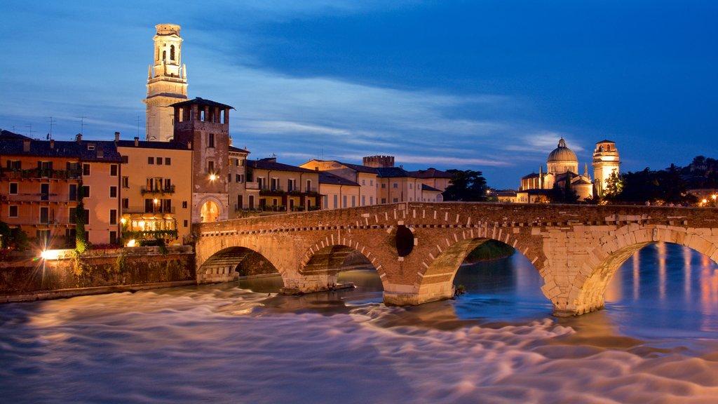 Verona featuring night scenes, a bridge and a river or creek