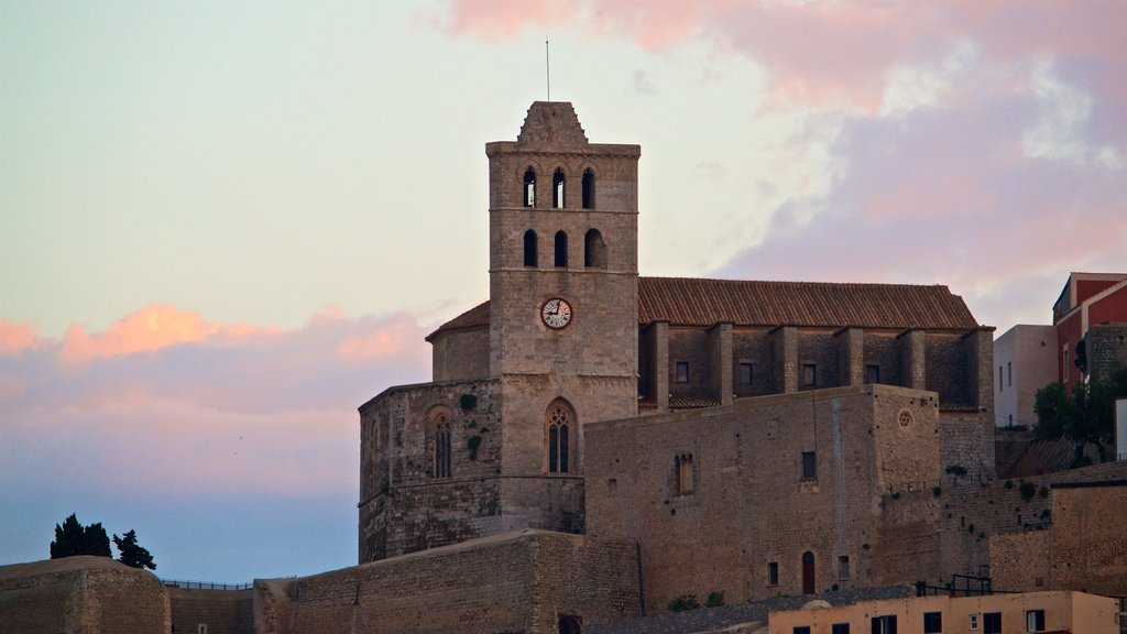 Ibiza City Centre showing heritage architecture and a sunset