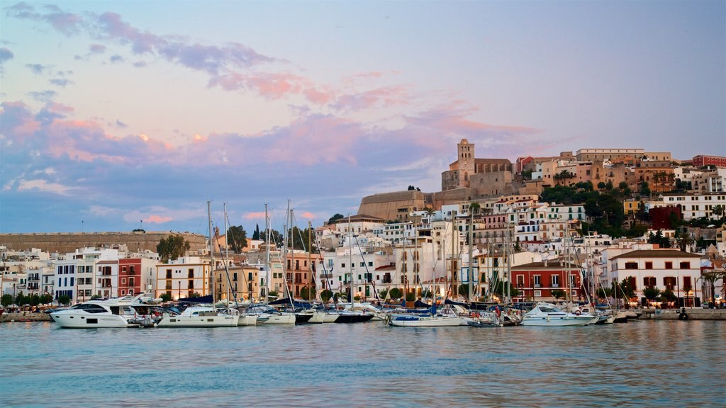 Ibiza City Centre which includes a coastal town, a bay or harbor and a sunset